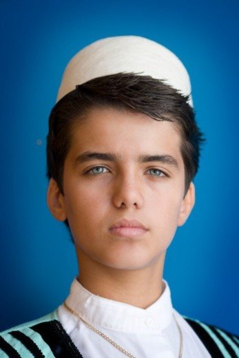 Portrait of teenage boy (13-14) wearing traditional Albanian costume : Stock Photo