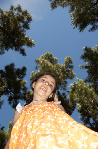Stock Photo: 1527R-1168639 Girl (6-7) outdoors, portrait, view from below