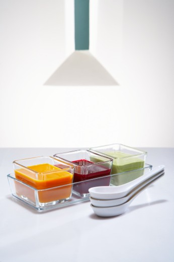 Dish with carrot soup, beet soup and cream of asparagus soup : Stock Photo