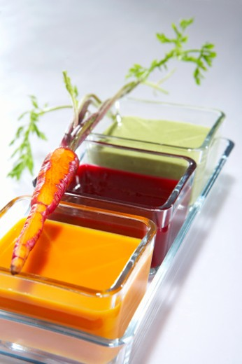 Dish with carrot soup, beet soup and asparagus soup with carrot : Stock Photo