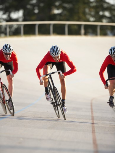 Stock Photo: 1527R-1169251 Cyclists in action on velodrome track