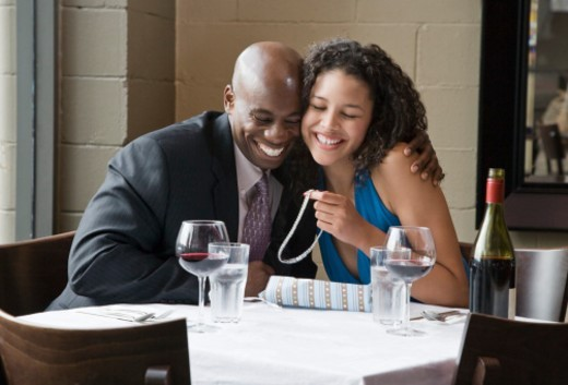 Couple looking at necklace in restaurant : Stock Photo