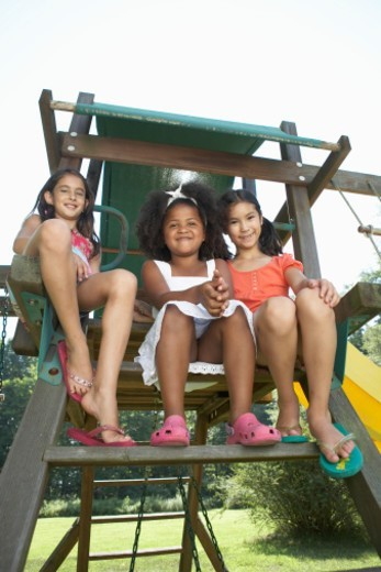Three girls (5-9) in playground, portrait : Stock Photo