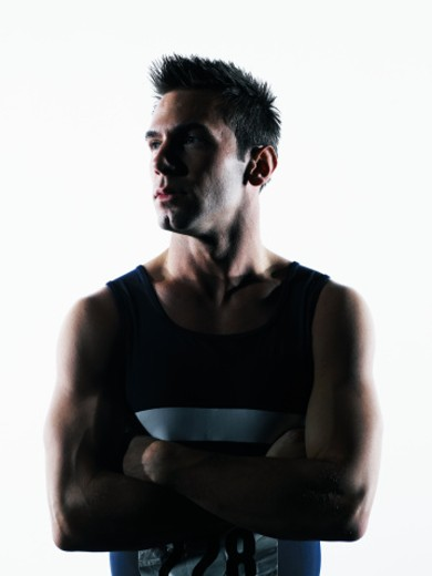 Male athlete with arms crossed : Stock Photo