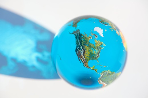 Glass globe with North America prominent, elevated view, close-up : Stock Photo