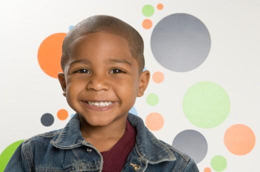 Boy (2-4) smiling, portrait : Stock Photo