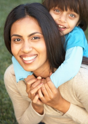 Stock Photo: 1527R-1175851 Woman and child (2-4) embracing, smiling, portrait