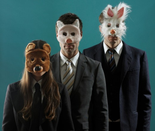 Stock Photo: 1527R-1178583 3 people in suits wearing animal masks