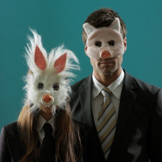 Stock Photo: 1527R-1178597 Professional man and woman wearing animal masks, portrait