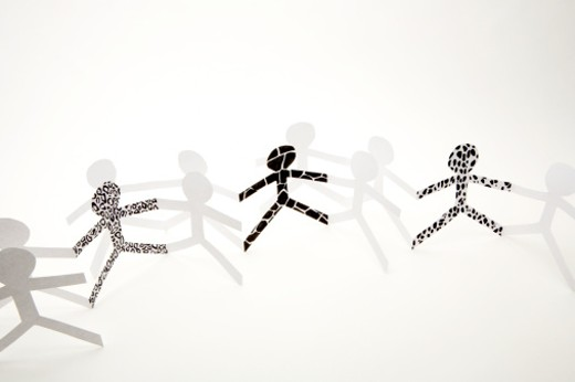 Line of white paper chain dolls : Stock Photo