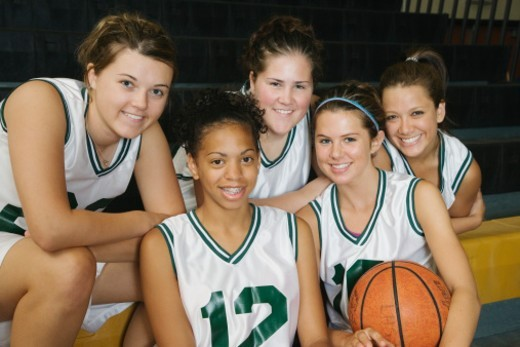 Female basketball team smiling, portrait : Stock Photo
