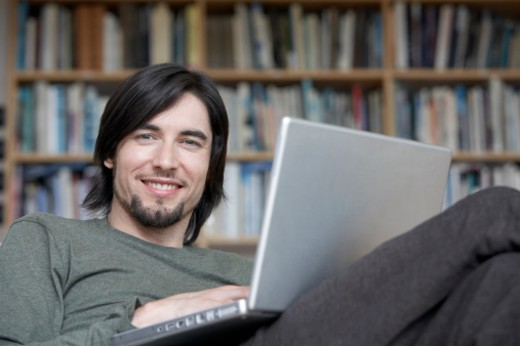 Stock Photo: 1527R-1186088 Man using laptop, smiling, portrait