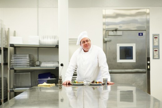 Stock Photo: 1527R-1186908 Chef with food in kitchen