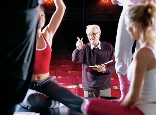 Stock Photo: 1527R-1188300 Theatre Director Directing Dancers Rehearsing on Stage