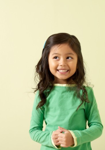 Girl (4-5) smiling, looking away : Stock Photo