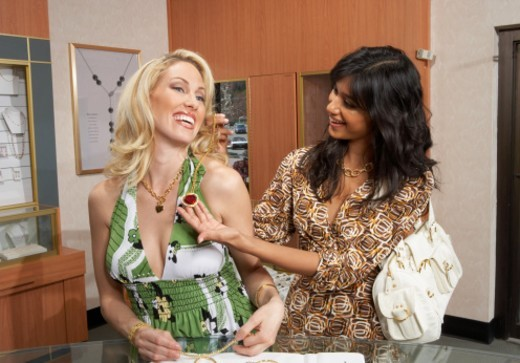 Two women looking shopping for jewellery : Stock Photo