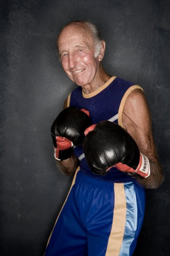Senior man in boxing pose, portrait, upper half : Stock Photo