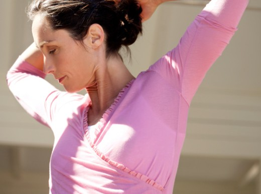 Woman stretching, eyes closed, close-up : Stock Photo