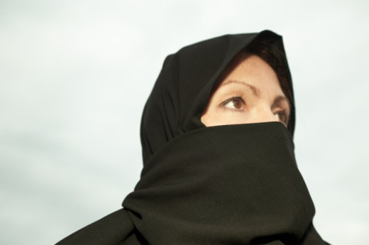 Woman wearing chador, looking away : Stock Photo