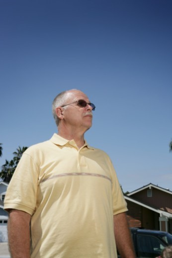 Senior man, low angle view : Stock Photo