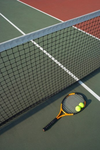 Stock Photo: 1527R-1197937 Tennis racket and balls on tennis court, elevated view