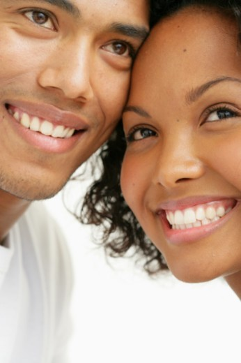 Stock Photo: 1527R-1204050 Young couple with heads together, smiling, close-up