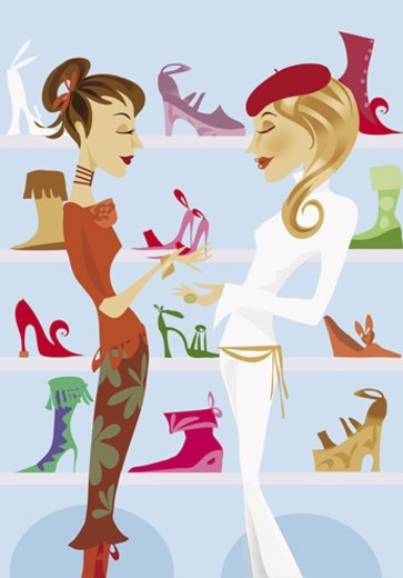 Shop Assistant Giving a Woman High Heels in a Shoe Shop : Stock Photo