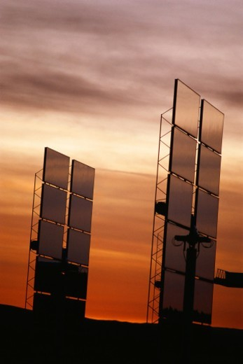 Stock Photo: 1527R-1205649 Upright solar panels against sunset