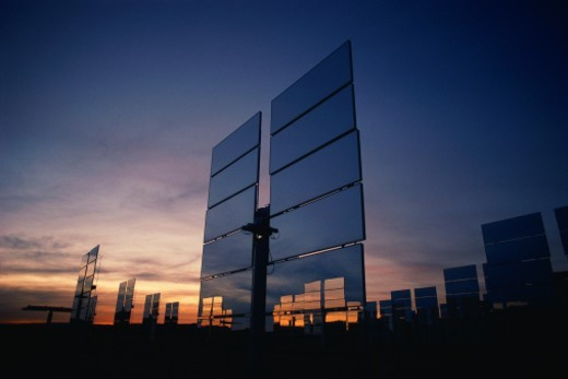 Stock Photo: 1527R-1205662 Upright solar panels at dusk