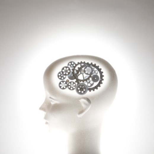 Mannequin head with gear wheels as brain : Stock Photo