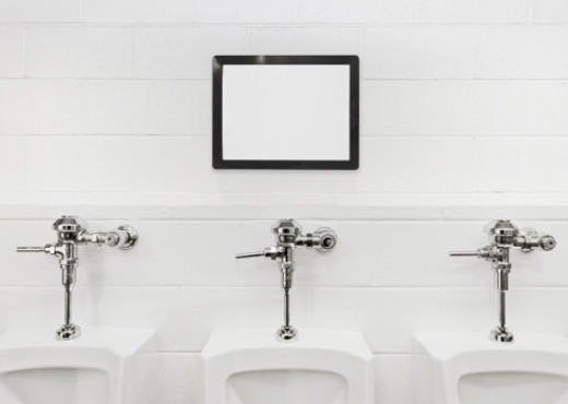 Blank sign board above urinals. : Stock Photo