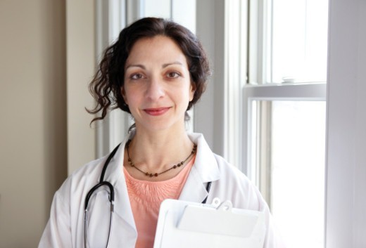 Stock Photo: 1527R-1206610 Portrait of female doctor with clipboard