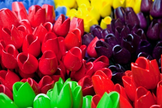 a colourful display of wooden tulips for sale in the Bloemenmarkt flower market : Stock Photo