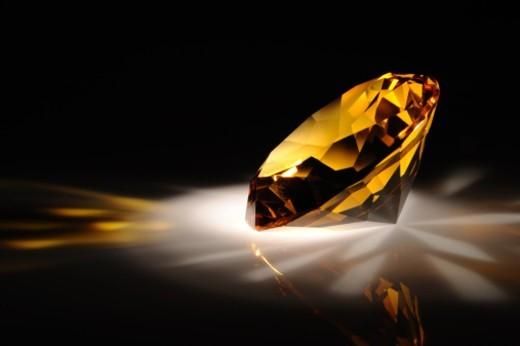 Shiny yellow diamond in dark : Stock Photo