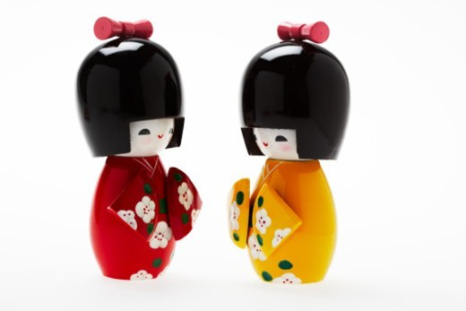 Japanese Wooden Dolls opposite one another : Stock Photo