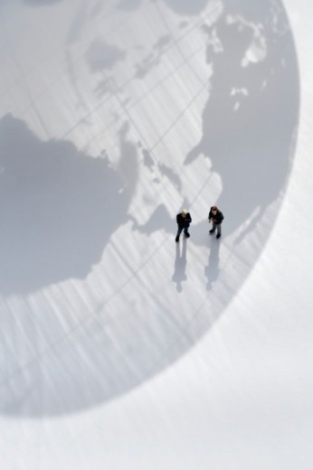 Stock Photo: 1527R-1208001 The shadow of the globe and the men of a miniature