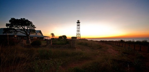 wide shot of the Gantheaume point lighthouse at sunset : Stock Photo