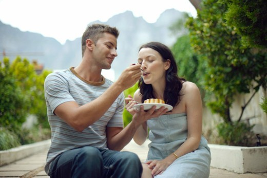 Stock Photo: 1527R-1208841 Man feeding woman dessert, Bakoven, Western Cape Province, South Africa