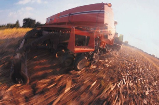 Harvester in field, blurred shot : Stock Photo