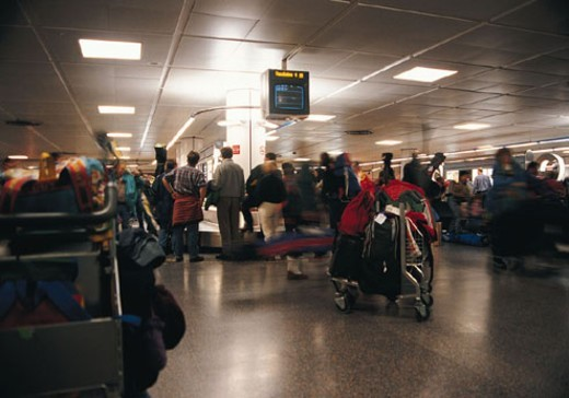 Stock Photo: 1527R-158085 Crowd waiting in airport terminal