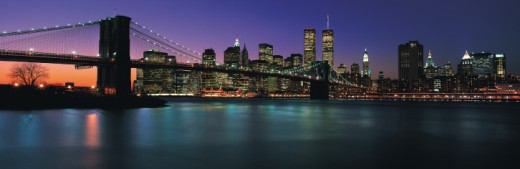 Stock Photo: 1527R-248069 Brooklyn Bridge in front of Manhattan skyline at dusk