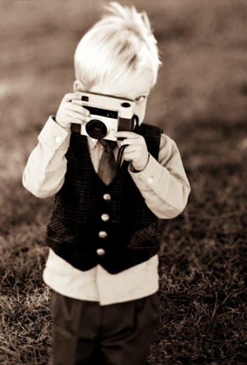 Young boy taking picture : Stock Photo