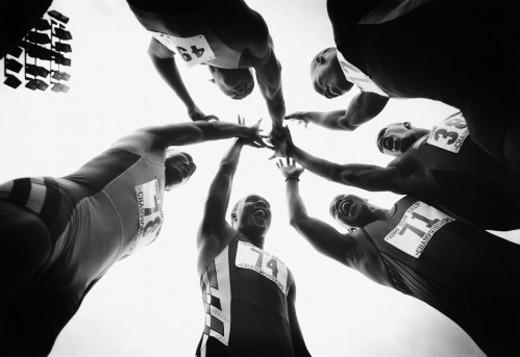 Celebrating track team : Stock Photo