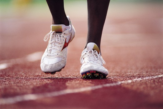 Feet of runner on track : Stock Photo