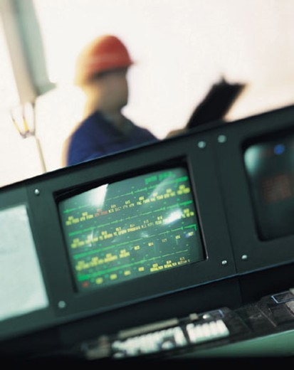 Man monitoring computer screens : Stock Photo