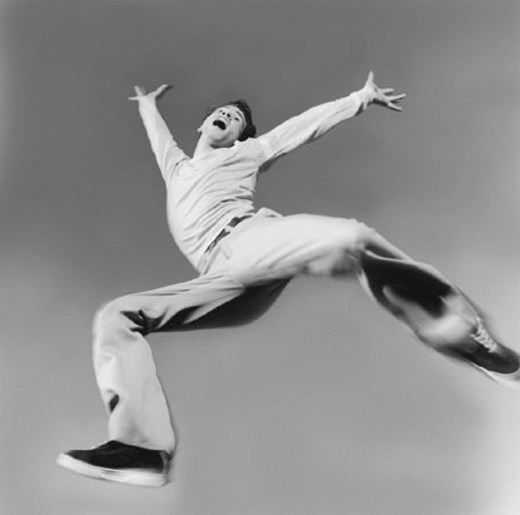 Stock Photo: 1527R-291069 Exuberant man jumping in air