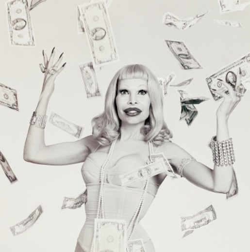 Woman with lots of money : Stock Photo
