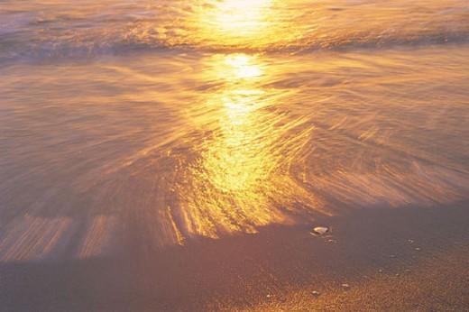 Sunlight reflection on beach, Cape Henlopen, Delaware, USA : Stock Photo
