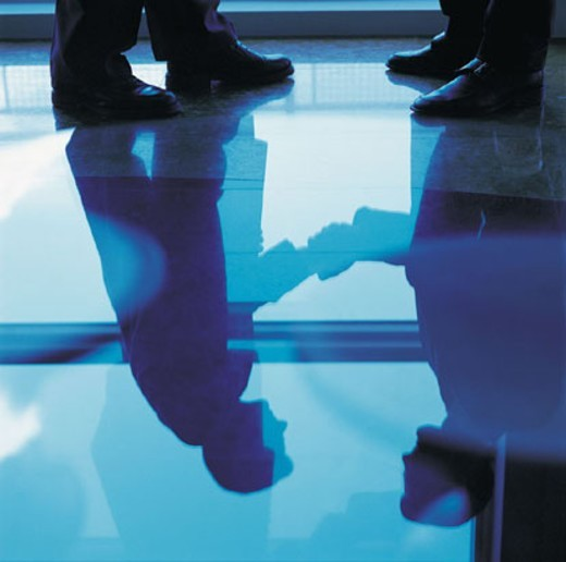 Reflection of a Handshake : Stock Photo