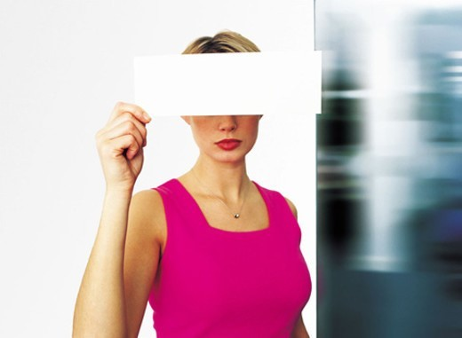 Woman holding blank paper : Stock Photo